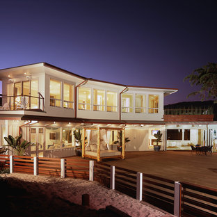Inspiration for a mid-sized coastal two-story flat roof remodel in Santa Barbara