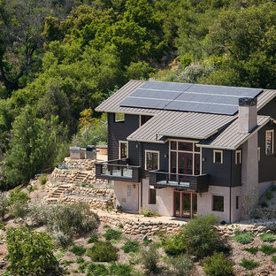 Example of a cottage gray two-story exterior home design in Santa Barbara