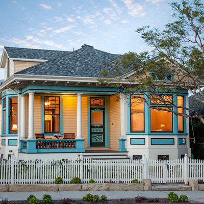 Example of a mid-sized ornate white two-story wood exterior home design in Santa Barbara