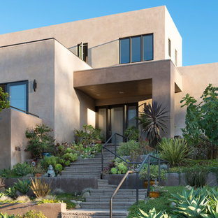 Inspiration for a mid-sized southwestern beige two-story stucco exterior home remodel in Santa Barbara