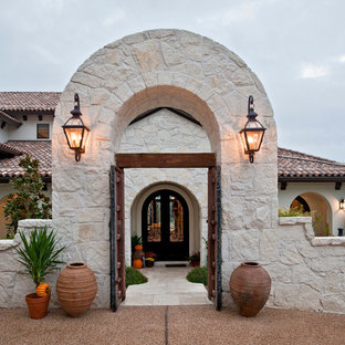 Inspiration for a mediterranean two floor house exterior in Austin.