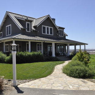 Mid-sized country brown two-story exterior home idea in Santa Barbara