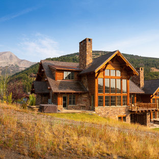 Example of a mountain style three-story wood exterior home design in Other