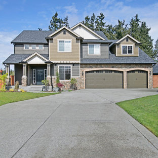 Inspiration for a large craftsman two-story concrete exterior home remodel in Seattle with a hip roof