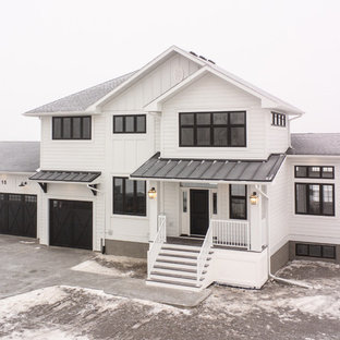 Country white two-story exterior home photo in Other with a shingle roof