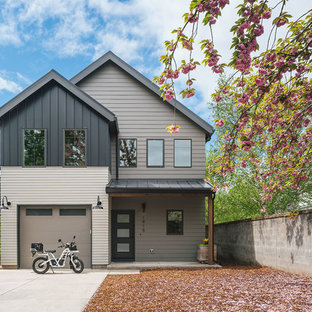 Small transitional black two-story concrete fiberboard exterior home idea in Portland with a metal roof