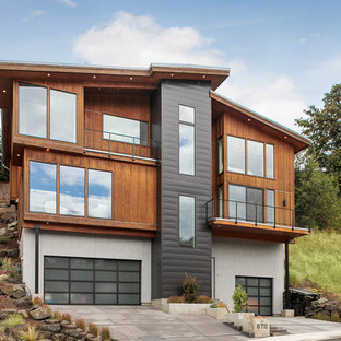 Inspiration for a contemporary multicolored three-story mixed siding exterior home remodel in Portland