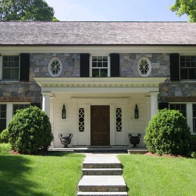 Elegant stone exterior home photo in New York