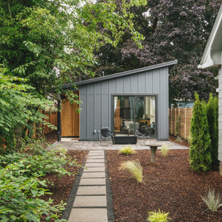 Inspiration for a small modern gray one-story wood house exterior remodel in Portland with a shed roof and a metal roof