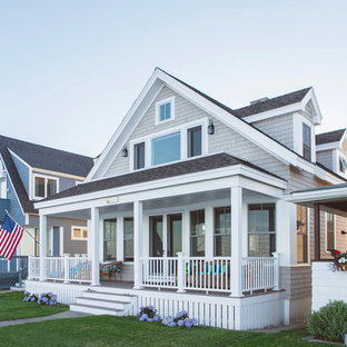 Inspiration for a small coastal beige two-story wood exterior home remodel in Boston