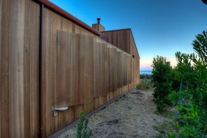 Midcentury Exterior by Hudson Street Design
