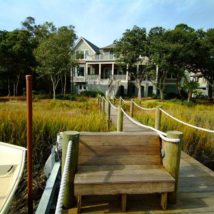 Large traditional gray three-story wood exterior home idea in Charleston with a shingle roof