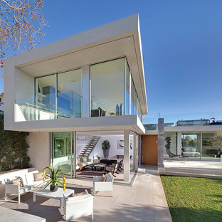 Inspiration for a large modern white two-story glass exterior home remodel in Los Angeles