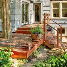 Eclectic Exterior by Blue Sound Construction, Inc.