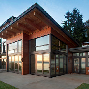Inspiration for a mid-sized contemporary two-story mixed siding exterior home remodel in Seattle with a shed roof
