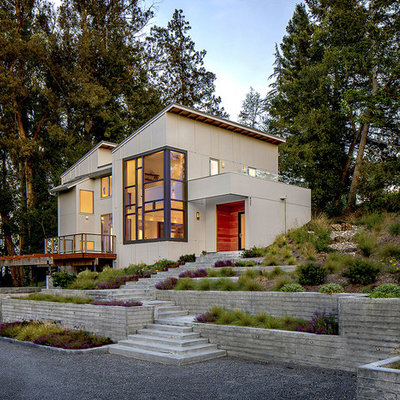 Inspiration for a mid-sized contemporary gray two-story concrete fiberboard house exterior remodel in San Francisco with a shed roof and a shingle roof
