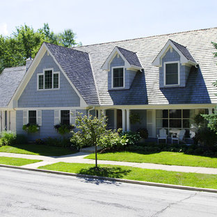 Mid-sized elegant blue two-story mixed siding gable roof photo in Chicago