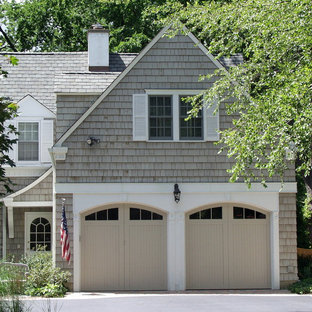 Mid-sized traditional beige two-story wood exterior home idea in Chicago with a shingle roof