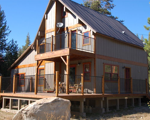 Example Of A Mid Sized Mountain Style Gray Two Story Wood Gable Roof Design