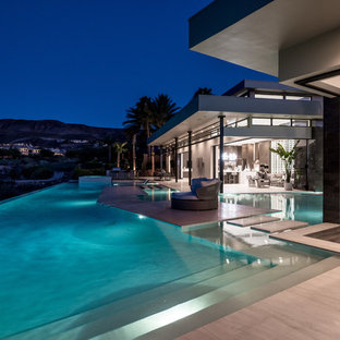 Large contemporary one-storey stucco white house exterior in Las Vegas with a flat roof.