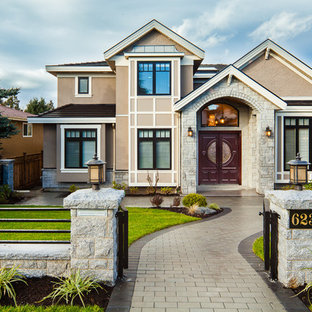Design ideas for a traditional two-storey exterior in Vancouver.