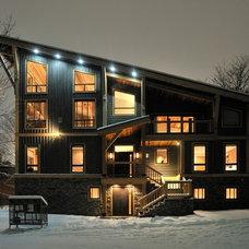 Contemporary Exterior by Sticks and Stones Design Group Inc