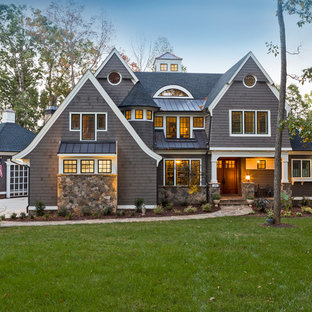 Large elegant gray three-story concrete fiberboard exterior home photo in Charlotte with a mixed material roof