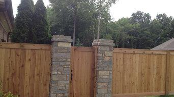 Shea rd cedar fence with stone pillars