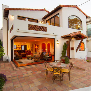 Inspiration for a mid-sized mediterranean white two-story stucco exterior home remodel in San Luis Obispo with a tile roof