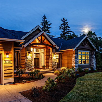 Inspiration for a mid-sized craftsman brown two-story mixed siding gable roof remodel in Portland