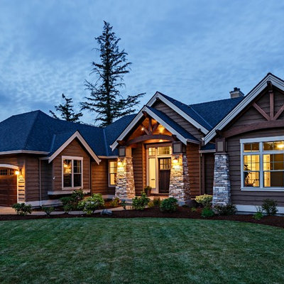 Mid-sized craftsman brown one-story mixed siding gable roof idea in Portland