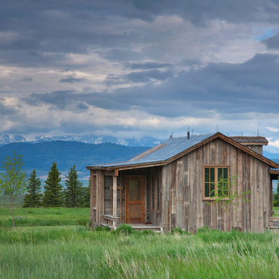 Inspiration for a small rustic one-story wood exterior home remodel in Other