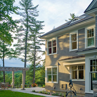 Inspiration for a large victorian gray two-story wood exterior home remodel in Burlington