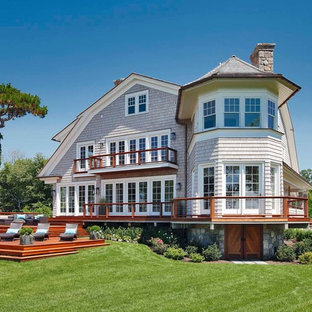 Coastal gray three-story wood exterior home photo in New York with a gambrel roof and a shingle roof