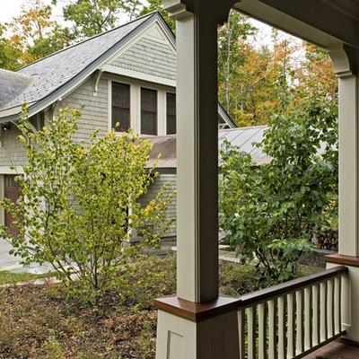 Example of a classic wood exterior home design in Burlington