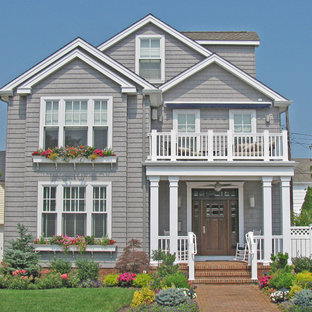 Example of a large classic gray two-story wood exterior home design in Philadelphia