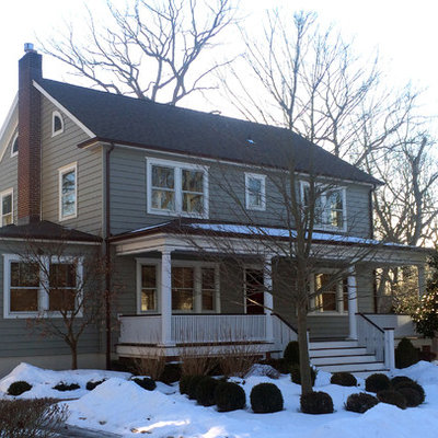 Mid-sized traditional gray two-story vinyl house exterior idea in New York with a hip roof and a shingle roof