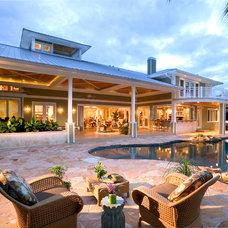 Tropical Exterior by Lancaster Interior Design