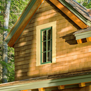 Example of a small mountain style brown two-story wood gable roof design in Boston