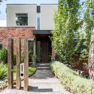 Design ideas for a contemporary two-storey multi-coloured house exterior in Melbourne with mixed siding and a flat roof.