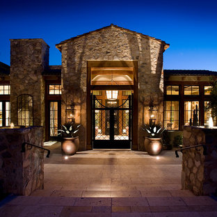Photo of a mediterranean exterior in Phoenix with stone cladding.