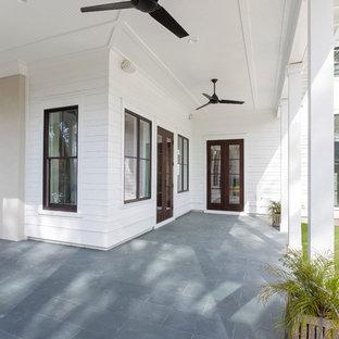 Large farmhouse white two-story concrete fiberboard gable roof idea in Charleston