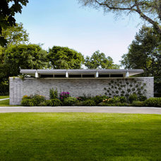 Midcentury Exterior by Welch Forsman Associates
