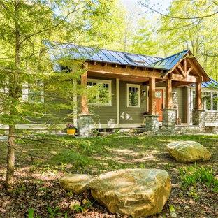 На фото: маленький, двухэтажный, деревянный, бежевый частный загородный дом в стиле кантри с двускатной крышей и металлической крышей