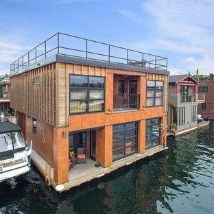 Idéer för ett mycket stort industriellt oranget hus, med platt tak och två våningar