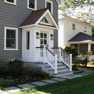 Mid-sized transitional gray two-story vinyl gable roof photo in New York with a metal roof