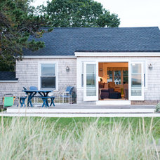Beach Style Exterior by Caleb Johnson Architects + Builders