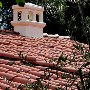 Mid-sized mediterranean white one-story stucco house exterior idea in Santa Barbara with a hip roof and a tile roof