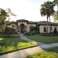 Mediterranean Exterior by MJS Inc. Custom Home Designs