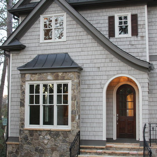 Inspiration for a large timeless gray two-story wood exterior home remodel in Atlanta
